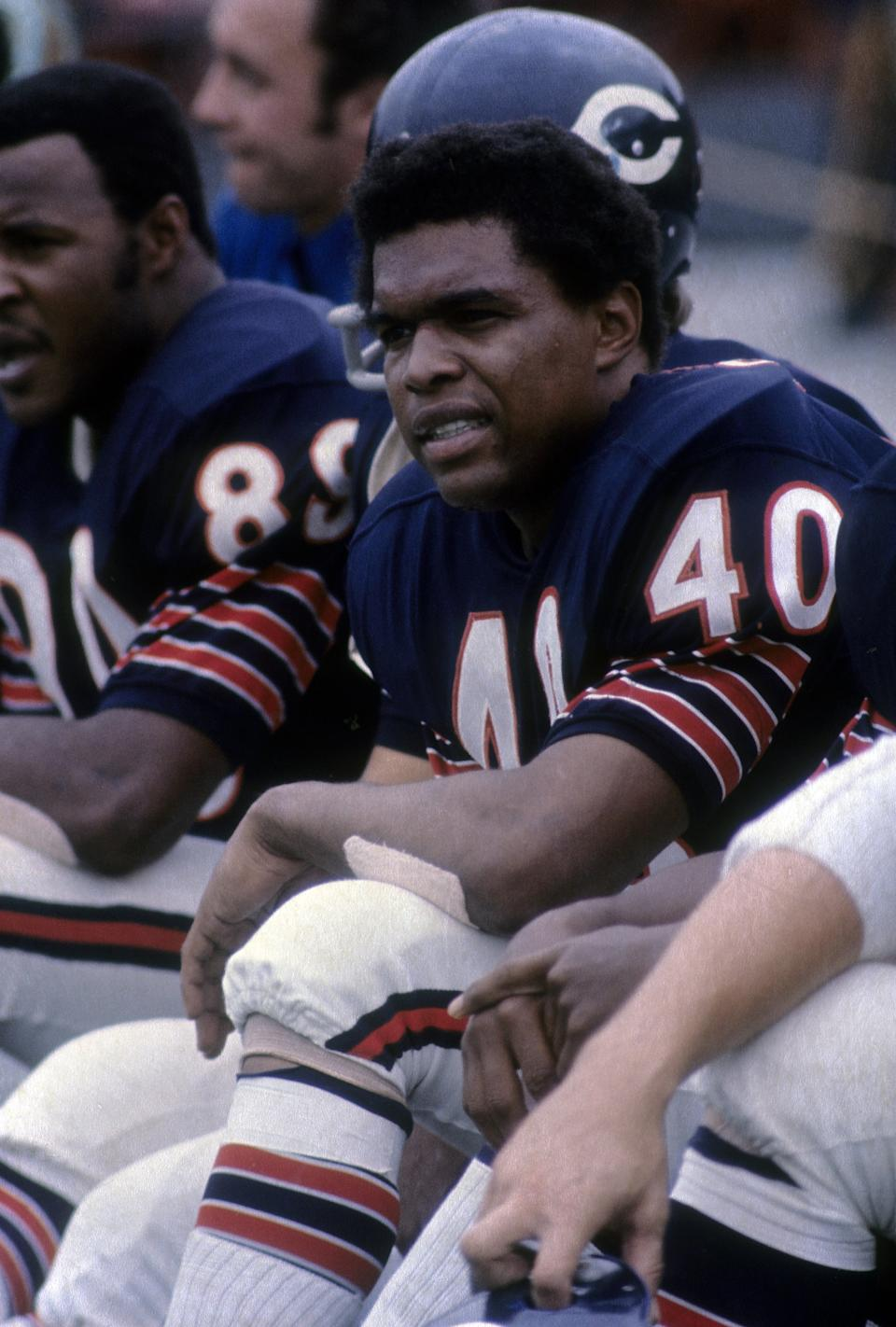 """One of the most dynamic players in NFL history, Sayers immediately made an impact in the NFL, setting a rookie record with 22 touchdowns in 1965. The """"Kansas Comet"""" got better from there. He was an All-Pro in each of his first five seasons and won two rushing titles. An electric kickoff returner, he retired as the league's all-time leader in return yards. Despite his career being cut short by injuries, Sayers was a first-ballot Hall of Fame selection in 1977. Sayers was 77 years old."""