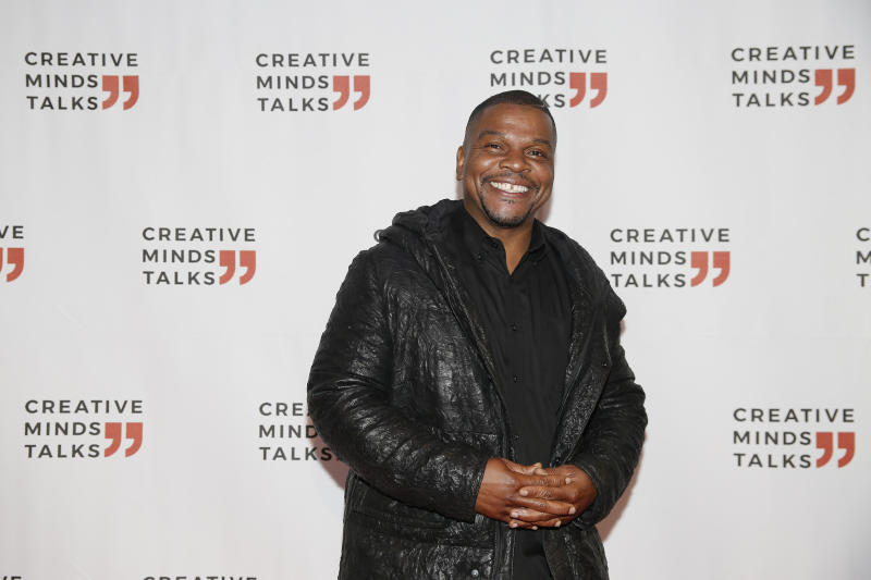 Kehinde Wiley arrives to a Creative Minds Talks during Art Basel, Monday, Dec. 2, 2019, in Miami Beach, Fla. (AP Photo/Brynn Anderson)
