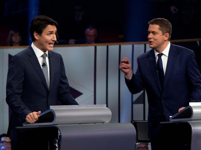 Liberal leader Justin Trudeau and Conservative leader Andrew Scheer take part in the Federal leaders French language debate: REUTERS