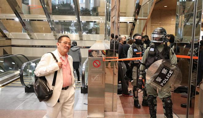 Riot police stand guard at Times Square mall in Causeway Bay. Photo: Nora Tam