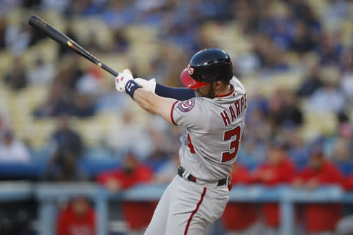 Washington Nationals' Bryce Harper hits an RBI single during the first inning of a baseball game against the Los Angeles Dodgers, Friday, April 20, 2018, in Los Angeles. (AP Photo/Jae C. Hong)