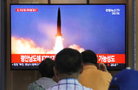 "People watch a TV showing a file image of a North Korea's missile launch during a news program at the Seoul Railway Station in Seoul, South Korea, Tuesday, Sept. 10, 2019. North Korea launched at least two unidentified projectiles toward the sea on Tuesday, South Korea's military said, hours after the North offered to resume nuclear diplomacy with the United States but warned its dealings with Washington may end without new U.S. proposals. The sign reads ""North Korea launched at least two unidentified projectiles."" (AP Photo/Ahn Young-joon)"