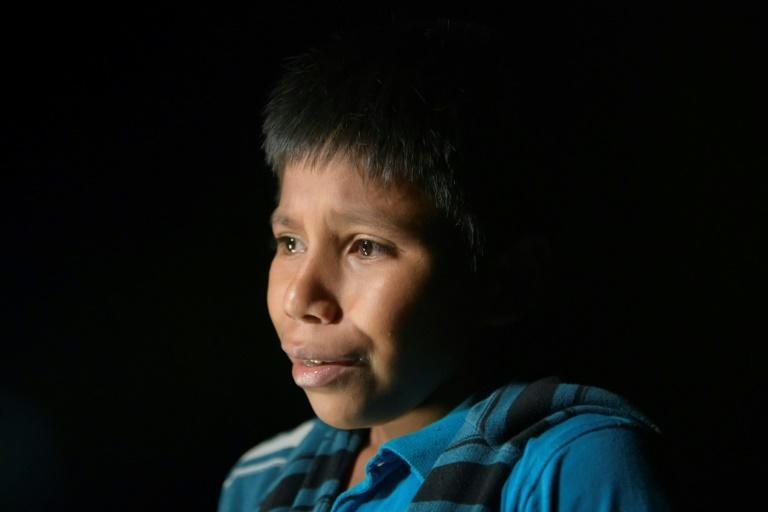In a photo taken on March 27, 2021 in Roma, Texas, 12-year-old Oscar tearfully recounts his solo journey from his native Guatemala
