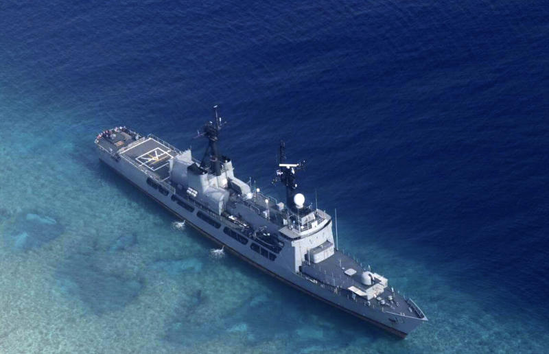 FILE - In this Aug. 31, 2018, file photo provided by the Armed Forces of the Philippines, the Philippine Navy ship BRP Gregorio del Pilar is seen after it ran aground during a routine patrol on Aug. 29, in the vicinity of Half Moon Shoal, which is called Hasa Hasa in the Philippines, off the disputed Spratlys Group of islands in the South China Sea. Philippine officials say they notified China about a navy frigate that ran aground near a hotly disputed area of the South China Sea in hopes of avoiding any misunderstandings. (Armed Forces of the Philippines via AP)