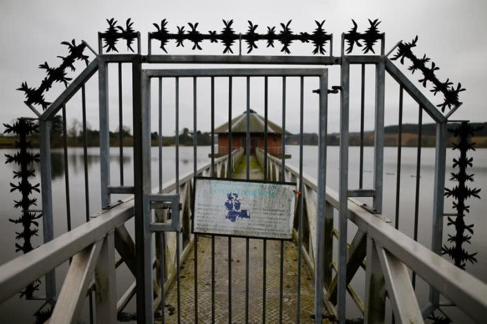 A sign hangs on a gate at Severn Trent Water's Cropston Reservoir