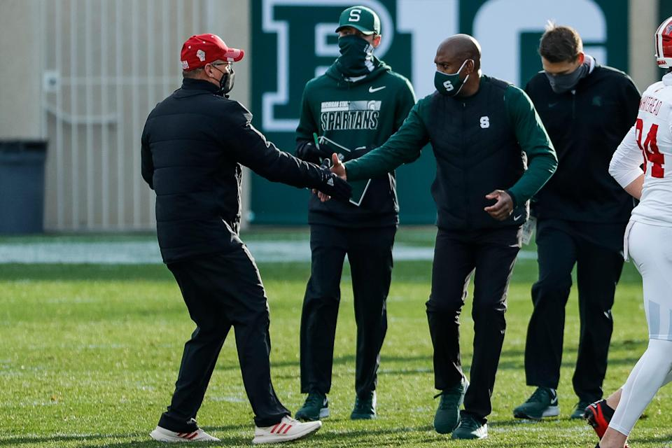 Indiana coach Tom Allen and Michigan State coach Mel Tucker shake hands after MSU's 24-0 loss to Indiana at Spartan Stadium on Saturday, Nov. 14, 2020.
