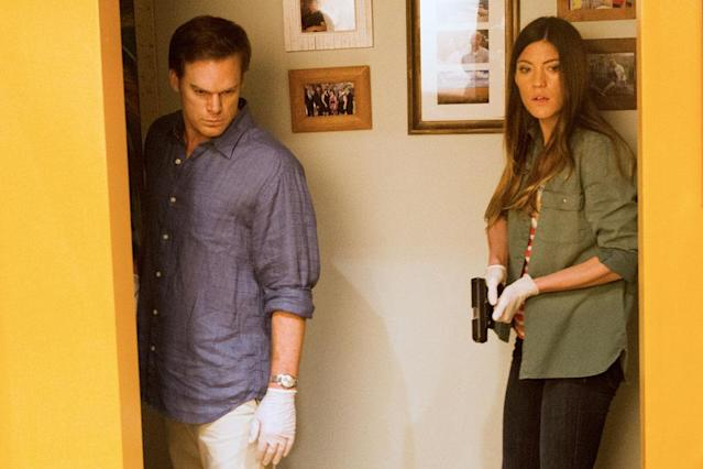 "Michael C. Hall as Dexter Morgan and Jennifer Carpenter as Debra Morgan in the ""Dexter"" Season 8 episode, ""This Little Piggy."""
