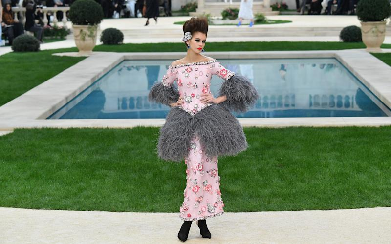 Feather-trimmed dress: Fantasy... Chic as anything. Reality... Lady who keeps chickens that may recently have been savaged by Fantastic Mr Fox. - 2019 Stephane Cardinale - Corbis