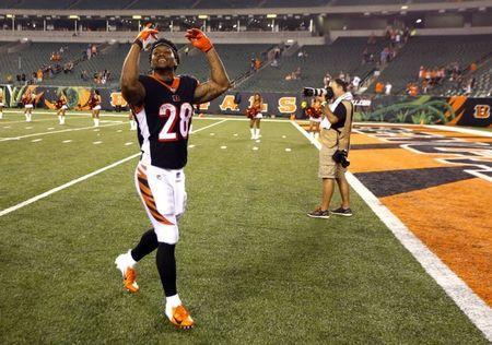 FILE PHOTO: Sep 13, 2018; Cincinnati, OH, USA; Cincinnati Bengals running back Joe Mixon (28) reacts to the fans after the Bengals defeated the Baltimore Ravens at Paul Brown Stadium. Mandatory Credit: David Kohl-USA TODAY Sports/File Photo