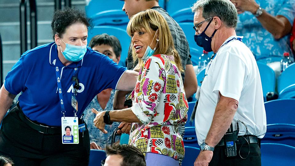 The woman, pictured here being kicked out of Rod Laver Arena for abusing Rafael Nadal.
