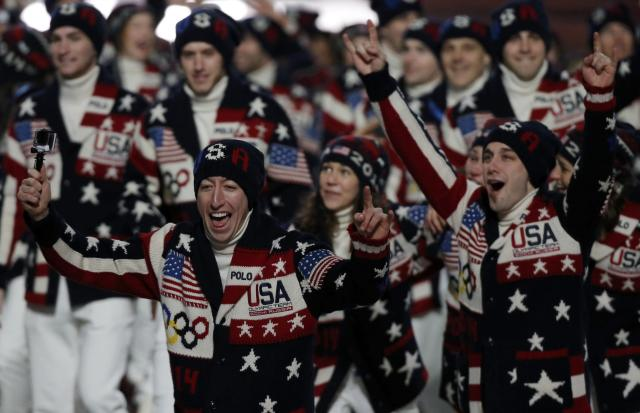 Athletes of the U.S. cheer during the opening ceremony of the 2014 Sochi Winter Olympics, February 7, 2014. REUTERS/Phil Noble (RUSSIA - Tags: OLYMPICS SPORT)