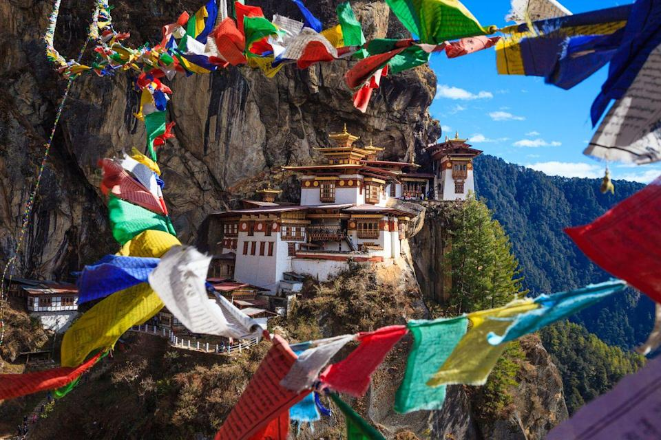 """<p>Perched on a steep cliff in Bhutan's Paro Valley, the """"Tiger's Nest"""" earned its nickname from an 18th-century tale detailing Buddhist master Padmasambhava arriving to the mediation site on a flying tiger. It's said he then mediated in a cave on the mountain for three years, bringing miracles to the surrounding areas and Buddhism to Bhutan. The journey to the cliffside is quite the challenge, requiring guests to climb two hours on a very steep trail.</p>"""