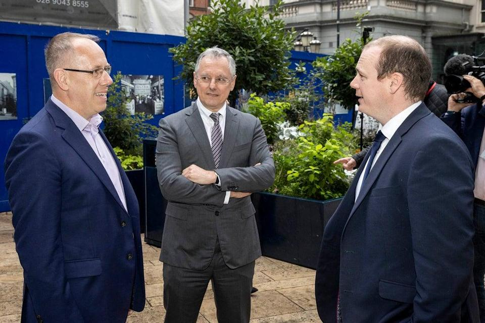 L-R Garvin McKee, Agio Chief Revenue Officer, Kevin Holland, Invest NI CEO, and Gordon Lyons, NI Economy Minister, chatting outside of Invest NI in Belfast. Minister Lyons announces New York company Agio to create 100 jobs. PA Photo. Picture date: Monday September 13 2021. See PA story ULSTER Jobs. Photo credit should read: Liam McBurney/PA Wire