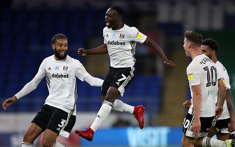 Fulham's Neeskens Kebano celebrates scoring his side's second goal of the game during the Sky Bet Championship play-off match at the Cardiff City Stadium, Cardiff. - PA
