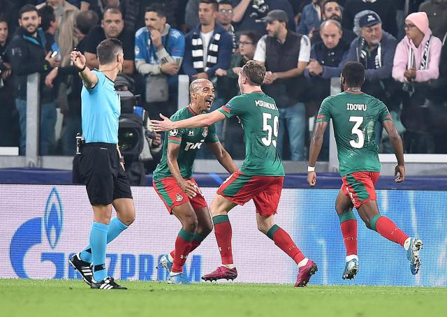 Lokomotiv Moscow's Aleksej Mirancuk, center, celebrates with his teammates after scoring a goal during the UEFA Champions League group D soccer match against Juventus FC at the Allianz Stadium in Turin, Italy, Tuesday, Oct. 22, 2019. (Alessandro Di Marco/ANSA via AP)