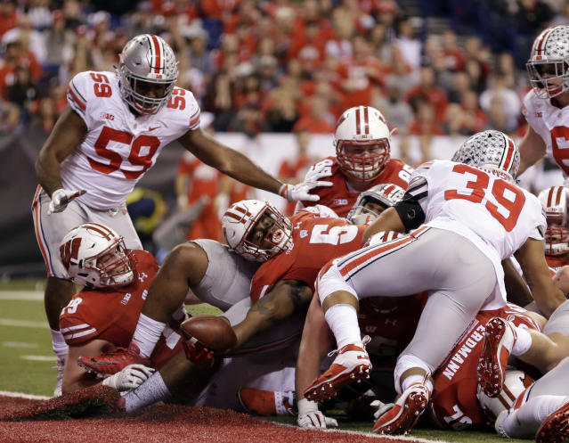 "Wisconsin running back <a class=""link rapid-noclick-resp"" href=""/ncaaf/players/240607/"" data-ylk=""slk:Chris James"">Chris James</a> (5) scores during the second half of the Big Ten championship NCAA college football game against Ohio State, Saturday, Dec. 2, 2017, in Indianapolis. (AP Photo/AJ Mast)"