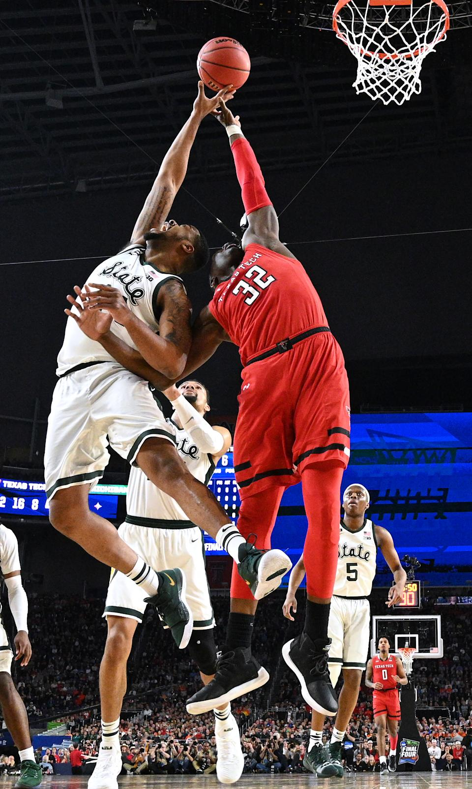 Nick Ward #44 of the Michigan State Spartans and Norense Odiase #32 of the Texas Tech Red Raiders battle for a rebound of the semifinal game in the NCAA Men's Final Four at U.S. Bank Stadium on April 06, 2019 in Minneapolis, Minnesota. (Photo by Brett Wilhelm/NCAA Photos via Getty Images)