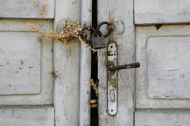 <p>The locked door of an abandoned house is seen in the village of Aldinac, near the southeastern town of Knjazevac, Serbia, Aug. 15, 2017. (Photo: Marko Djurica/Reuters) </p>