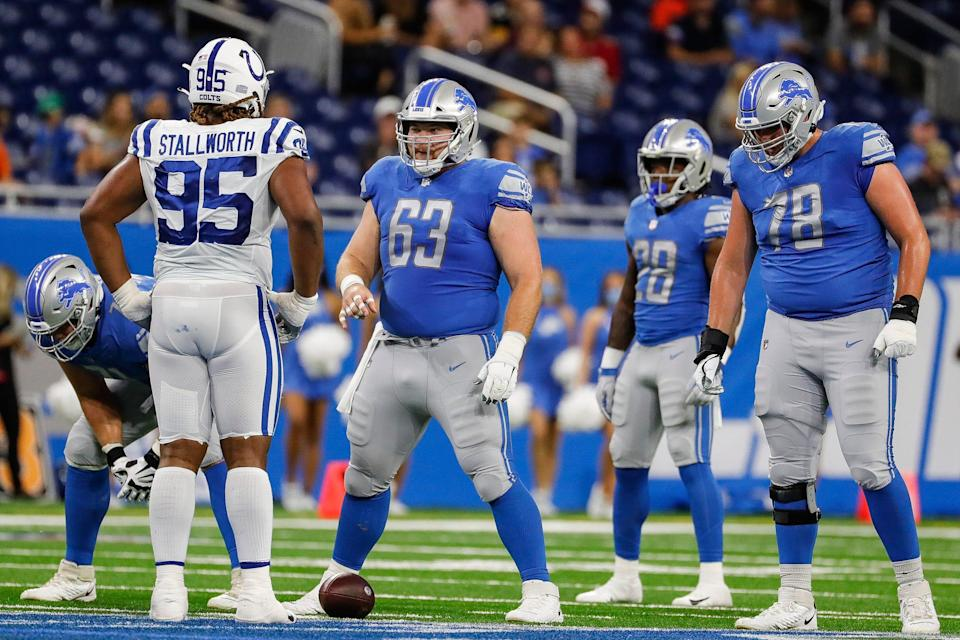 Detroit Lions center Evan Brown (63) and guard Tommy Kraemer (78) get ready for a snap against the Indianapolis Colts during the first half of a preseason game at Ford Field in Detroit on Friday, Aug. 27, 2021.