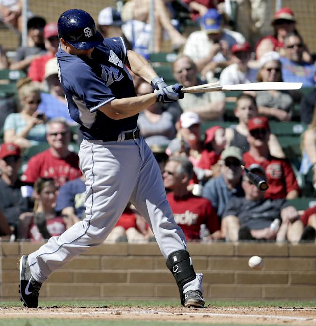 San Diego Padres' Nick Hundley breaks his bat and grounds out in the first inning against the Arizona Diamondbacks during a spring exhibition baseball game in Scottsdale, Ariz., Sunday, March 9, 2014. (AP Photo/Chris Carlson)
