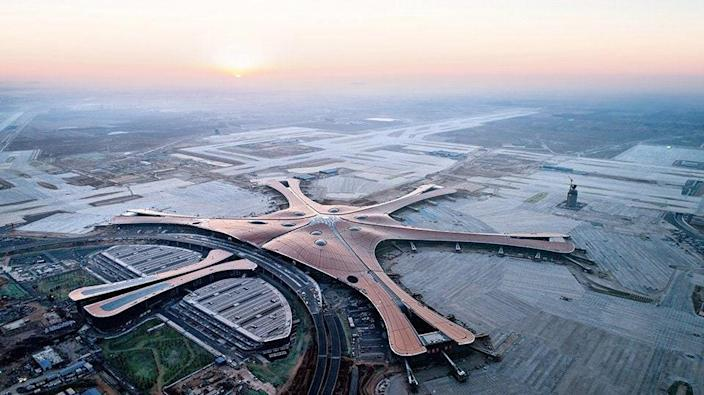 The new airport was built about 28 miles south of the city center and ZHA designed the terminal building and neighboring transportation center. The airport includes four runways and 79 gates within the six-pier design. By 2025, it will accommodate 72 million travelers per year.