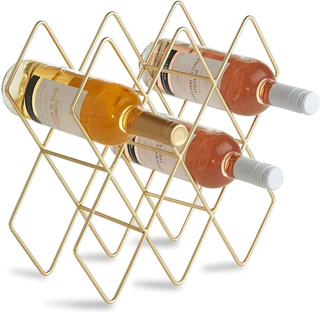 A sleek accessory that puts bottles in their place. (Photo: Amazon)
