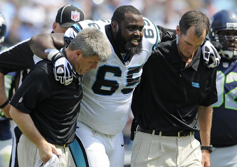 Carolina Panthers' Garry Williams (65) is helped off the field after being injured during the first half of an NFL football game against the Seattle Seahawks in Charlotte, N.C., Sunday, Sept. 8, 2013. (AP Photo/Mike McCarn)