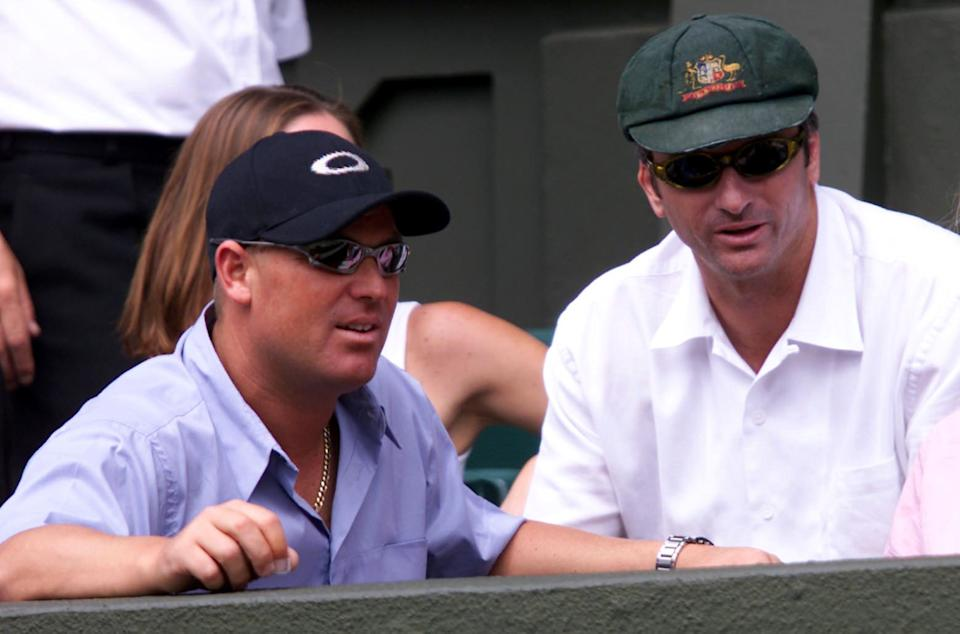 Australian cricket captain Steve Waugh and Shane Warne watch on as Patrick Rafter plays at Wimbledon.