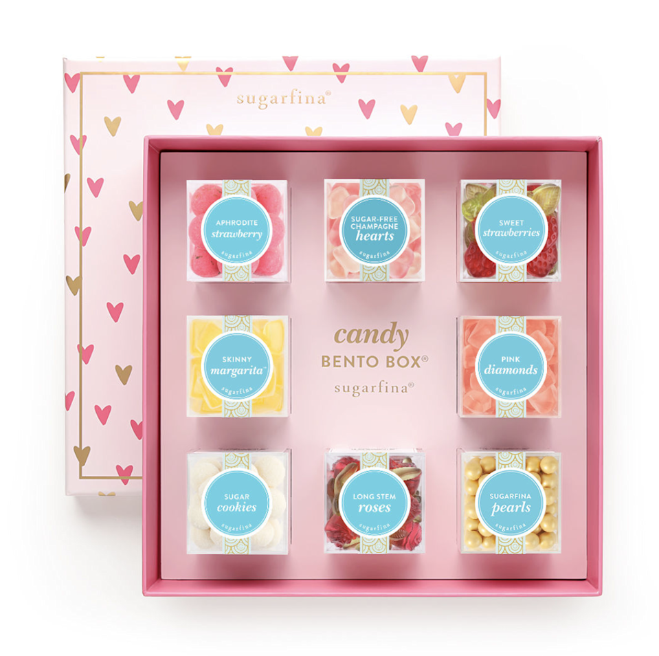 "<strong><h3><a href=""https://www.sugarfina.com/gift-shop/valentines-day-gifts"" rel=""nofollow noopener"" target=""_blank"" data-ylk=""slk:Sugarfina"" class=""link rapid-noclick-resp"">Sugarfina</a></h3></strong><br>Home of the OG and ever-popular rosé gummy bears, Sugarfina boasts an equally tasty lineup of specialty treats — from <a href=""https://www.sugarfina.com/gift-shop/recipient/treat-yourself/sugar-lips"" rel=""nofollow noopener"" target=""_blank"" data-ylk=""slk:sugar lips"" class=""link rapid-noclick-resp"">sugar lips</a> to <a href=""https://www.sugarfina.com/peach-bellini"" rel=""nofollow noopener"" target=""_blank"" data-ylk=""slk:peach bellini hearts"" class=""link rapid-noclick-resp"">peach bellini hearts</a>, <a href=""https://www.sugarfina.com/single-malt-scotch-cordials-cask-strength"" rel=""nofollow noopener"" target=""_blank"" data-ylk=""slk:dark chocolate-covered scotch cordials"" class=""link rapid-noclick-resp"">dark chocolate-covered scotch cordials</a>, <a href=""https://www.sugarfina.com/chocolate-vodka-shots"" rel=""nofollow noopener"" target=""_blank"" data-ylk=""slk:chocolate vodka shots"" class=""link rapid-noclick-resp"">chocolate vodka shots</a>, and much more — that can be shipped nationwide. <br><br><strong>Sugarfina</strong> XOXO 8 Piece Candy Bento Box, $, available at <a href=""https://go.skimresources.com/?id=30283X879131&url=https%3A%2F%2Fwww.sugarfina.com%2Fxoxo-8-piece-candy-bento-box"" rel=""nofollow noopener"" target=""_blank"" data-ylk=""slk:Sugarfina"" class=""link rapid-noclick-resp"">Sugarfina</a>"