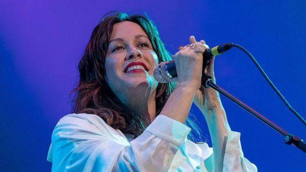 PHOTO: Alanis Morissette performs on stage with her band during Kaaboo Texas music festival at the AT&T Stadium in Arlington, Texas, May 10, 2019. (Suzanne Cordeiro/AFP/Getty Images)