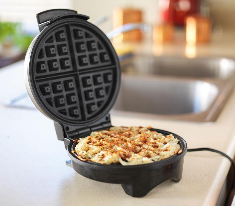"""<p>Your waffle iron isn't only for waffles! You can <a href=""""https://www.delish.com/cooking/recipe-ideas/g2821/ways-to-use-waffle-iron/"""" rel=""""nofollow noopener"""" target=""""_blank"""" data-ylk=""""slk:make a few different things in there"""" class=""""link rapid-noclick-resp"""">make a few different things in there</a>: hash browns, cinnamon buns, even omelettes. It can be faster and less of a mess than cooking on the stove, without sacrificing flavor.</p>"""