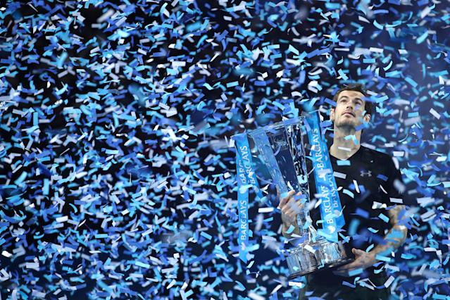 <p>Murray is showered with confetti after winning the 2016 ATP Masters at the 02 Arena. (Getty Images) </p>