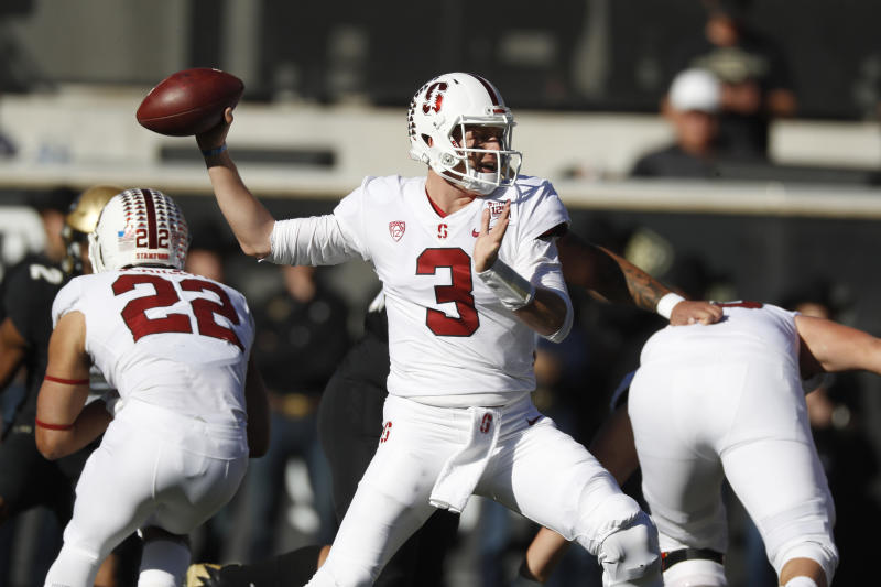 Stanford quarterback K.J. Costello throws a pass in the first half of an NCAA college football game against Colorado, Saturday, Nov. 9, 2019, in Boulder, Colo. (AP Photo/David Zalubowski)