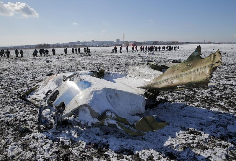 FILE PHOTO: Emergencies Ministry members work at the crash site of a Boeing 737-800 Flight FZ981 operated by Dubai-based budget carrier Flydubai, at the airport of Rostov-On-Don