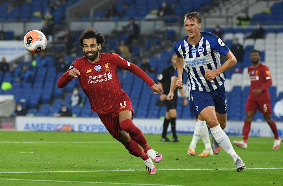Liverpool's Mohamed Salah (left) in action with Brighton's Dan Burn.