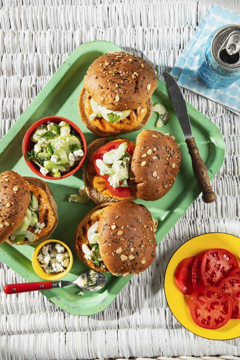 """<p>Cooking for folks that are avoiding red meat? This Buffalo-sauce-flavored burger is a beef-free crowd-pleaser.</p><p><strong><a href=""""https://www.countryliving.com/food-drinks/a36320250/turkey-burgers-with-blue-cheesecelery-slaw-recipe/"""" rel=""""nofollow noopener"""" target=""""_blank"""" data-ylk=""""slk:Get the recipe"""" class=""""link rapid-noclick-resp"""">Get the recipe</a>.</strong></p>"""