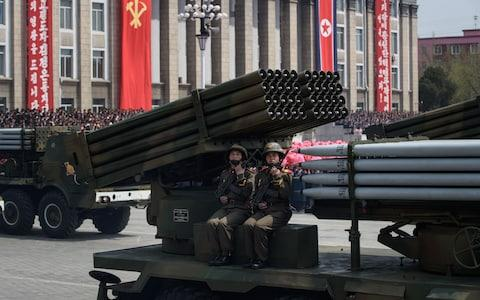 North Korean soldiers man a missile rocket launcher during mass military parades in Pyongyang - Credit: ED JONES/AFP/Getty Images
