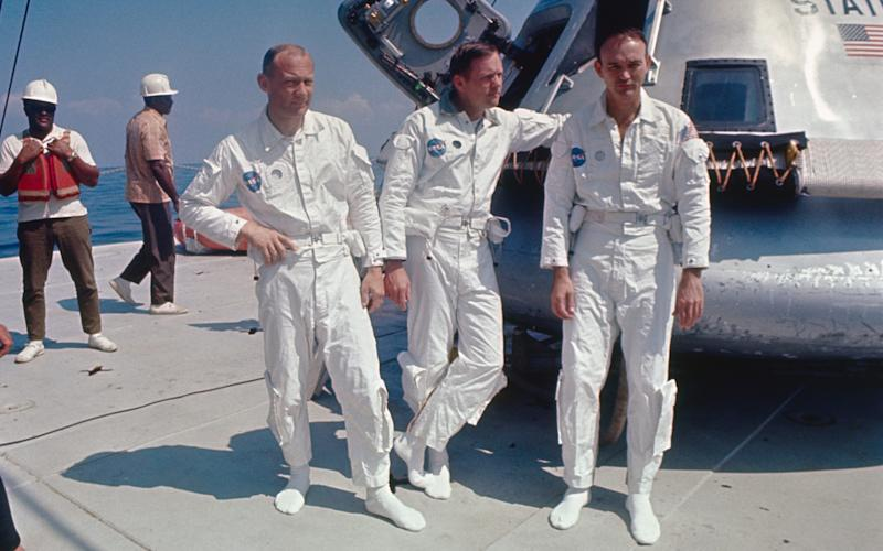 Aldrin, Armstrong and Collins beside an Apollo training capsule, 1969 - GETTY IMAGES