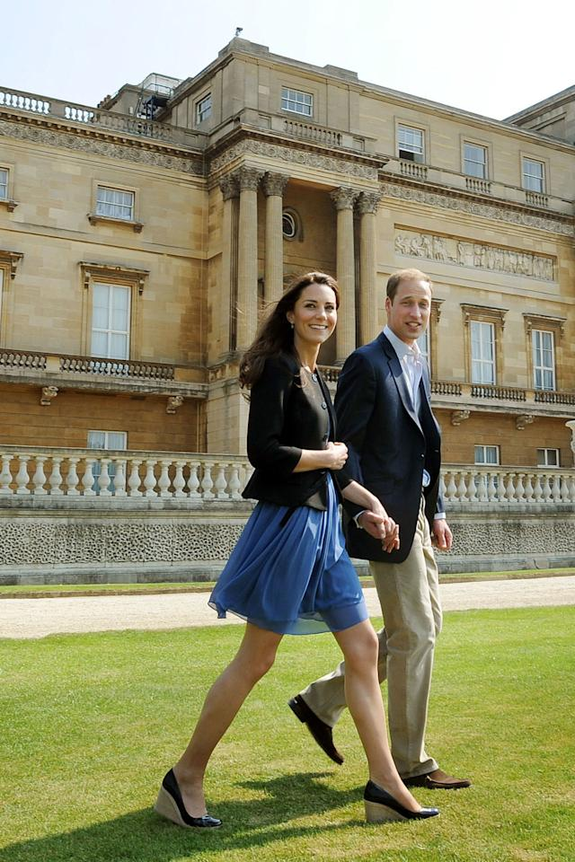 <p><i>April 30, 2011 -</i> As she left for her honeymoon, Kate paired a blue sundress with her go-to accessories: a blazer and wedge heels.</p>