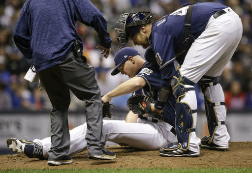 "With <a class=""link rapid-noclick-resp"" href=""/mlb/players/9712/"" data-ylk=""slk:Corey Knebel"">Corey Knebel</a> headed to the DL, the Brewers have an opening in the ninth inning (AP Photo/Tom Lynn)"