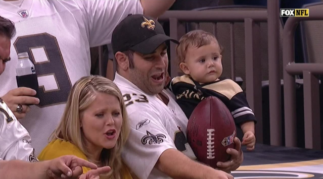 Saints Baby is cool with the football now. (via screenshot)