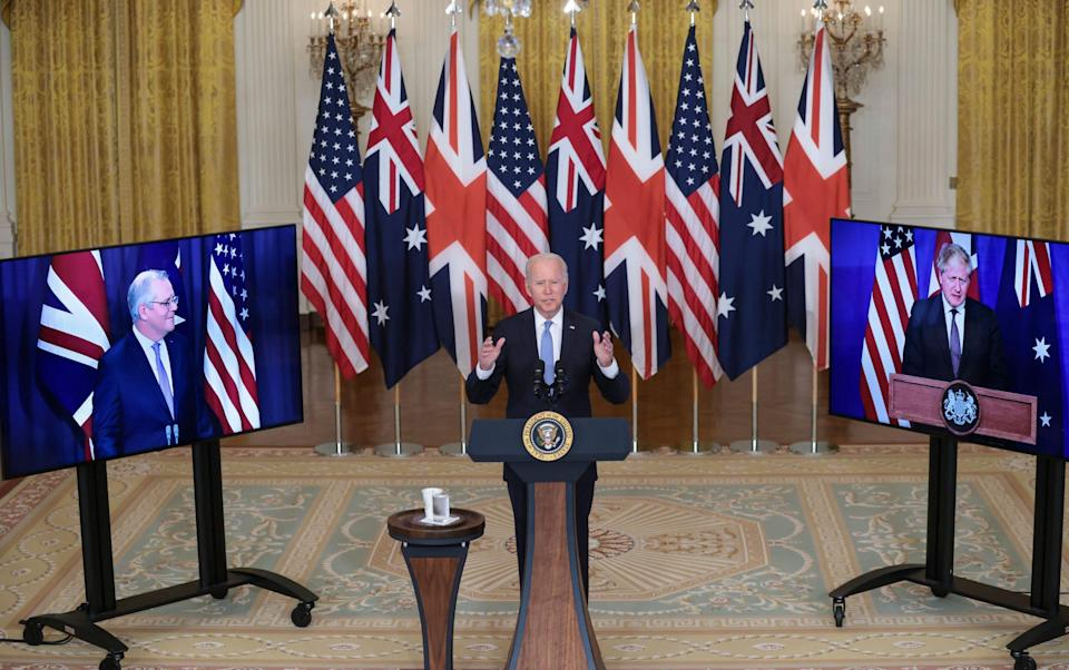 President Joe Biden delivers remarks about a national security initiative in the East Room of the White House in Washington, with Australian Prime Minister Scott Morrison and British Prime Minister Boris Johnson - Oliver Contreras
