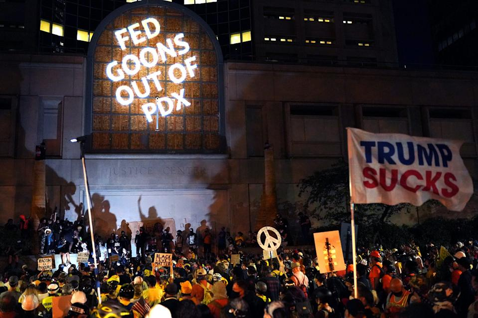 """A crowd of about 1,500 protester gather at the Multnomah County Justice Center in Portland on July 20, 2020. <p class=""""copyright""""><a href=""""https://www.gettyimages.com/detail/news-photo/crowd-of-about-1-500-protester-gather-at-the-multnomah-news-photo/1227718695?adppopup=true"""" rel=""""nofollow noopener"""" target=""""_blank"""" data-ylk=""""slk:Nathan Howard/Getty Images"""" class=""""link rapid-noclick-resp"""">Nathan Howard/Getty Images</a></p>"""