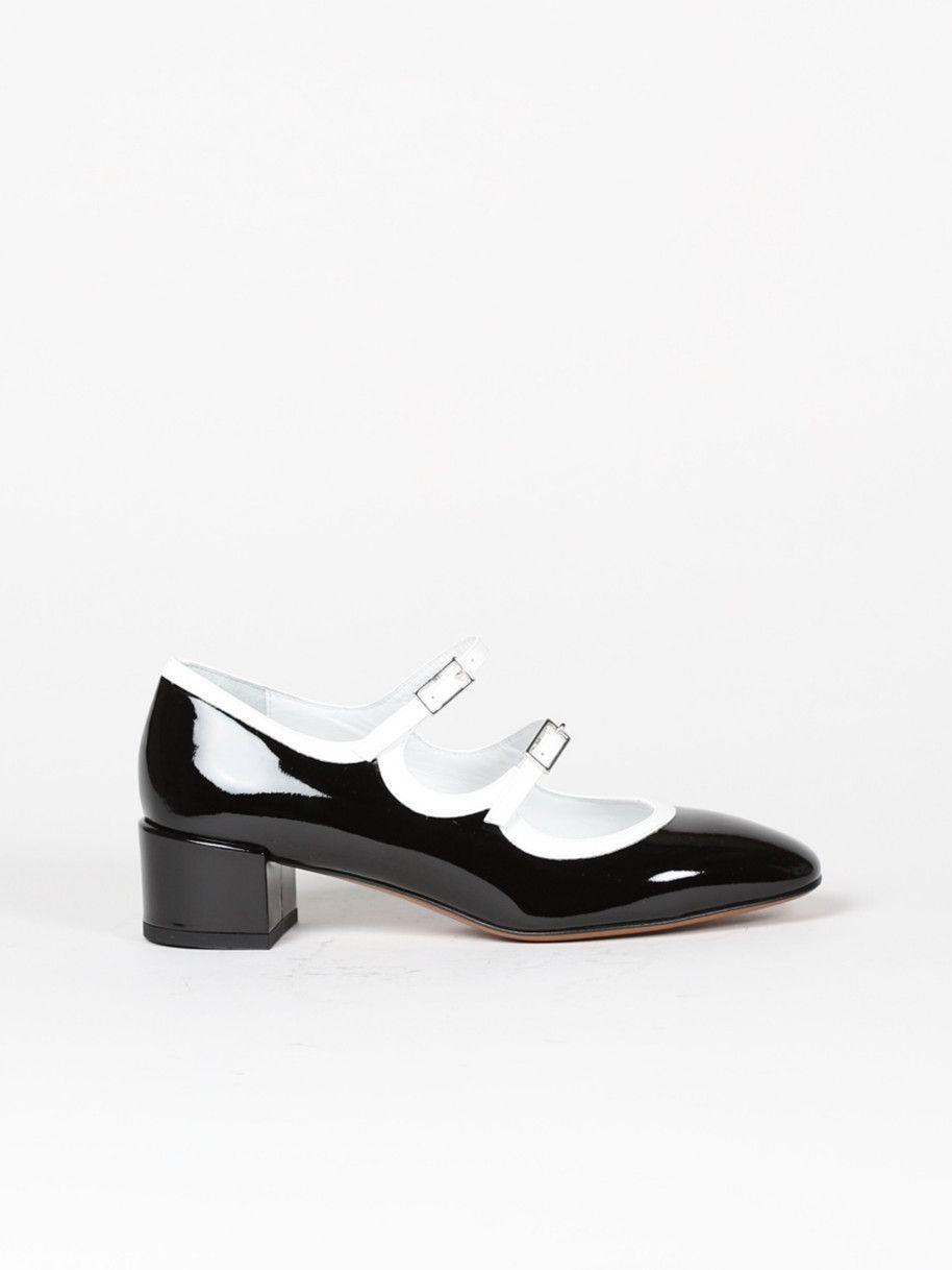 "<p>carel.fr</p><p><strong>270.83</strong></p><p><a href=""https://www.carel.fr/en/accueil/401-3646-Black-patent-leather-Mary-Janes.html#/size-36"" rel=""nofollow noopener"" target=""_blank"" data-ylk=""slk:Shop Now"" class=""link rapid-noclick-resp"">Shop Now</a></p><p>French It-girls have sworn by Carel's quirky take on the Mary Jane for years. This patent version with a double strap and a stacked heel is both fun, flirty, and very wearable.</p>"