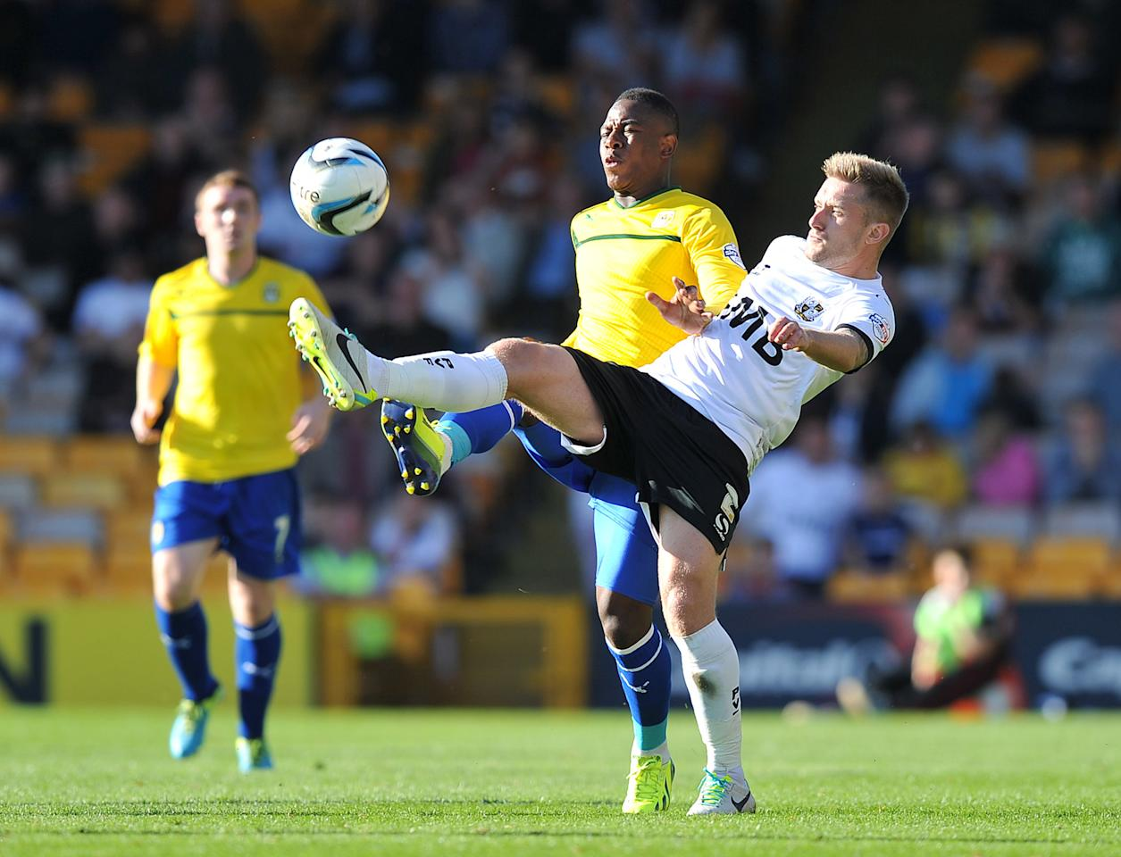Coventry City's Franck Moussa (left) and Port Vale's Adam Yates (right) battle for the ball during the Sky Bet League One match at Vale Park, Stoke.