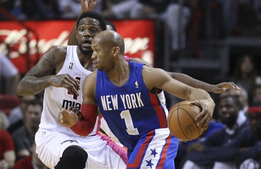 Miami Heat's Udonis Haslem (40) tries to block New Jersey Nets' Sundiata Gaines (1) during the first half of an NBA basketball game, Tuesday, March 6, 2012, in Miami. (AP Photo/J Pat Carter)