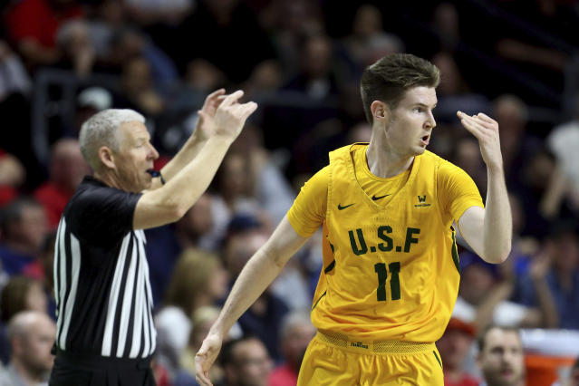 San Francisco's Remu Raitanen reacts after scoring a three-point basket during the first half of an NCAA college basketball game against Gonzaga in the West Coast Conference men's tournament Monday, March 9, 2020, in Las Vegas. (AP Photo/Isaac Brekken)