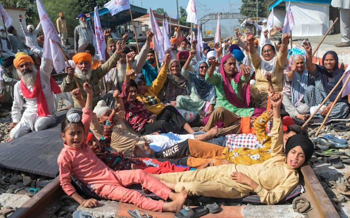 Farmers and their children protest the new bill - NARINDER NANU/AFP via Getty Images