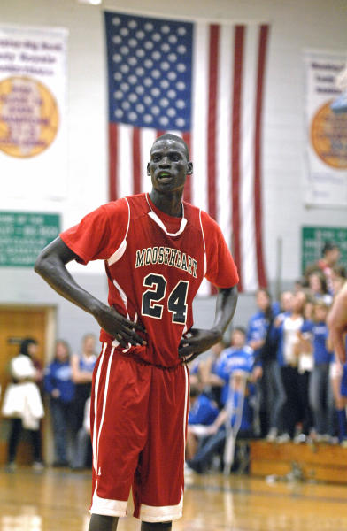 In this Dec. 5, 2012 photo, Mooseheart High School's Mangisto Deng waits for the ball at the free throw line during a high school basketball game against Hinckley-Big Rock in Hinckley, Ill. Deng is one of four Sudanese athletes who find themselves center court of a controversy in suburban Chicago over high schools recruiting athletes. The Illinois High School Association board will consider Monday, Dec. 10 whether the three basketball players and a cross-country runner are ineligible to continue competing for Mooseheart. The century-old school says it accepted the students as part of its tradition of helping troubled and poor students, but the ISHA's executive director determined that it broke a prohibition against recruiting athletes after accepting the young men from an Indiana outfit called A-HOPE, an Indiana-based foundation whose founder has drawn NCAA scrutiny. (AP Photo/Daily Herald, Laura Stoecker) MANDATORY CREDIT, MAGS OUT, TV OUT