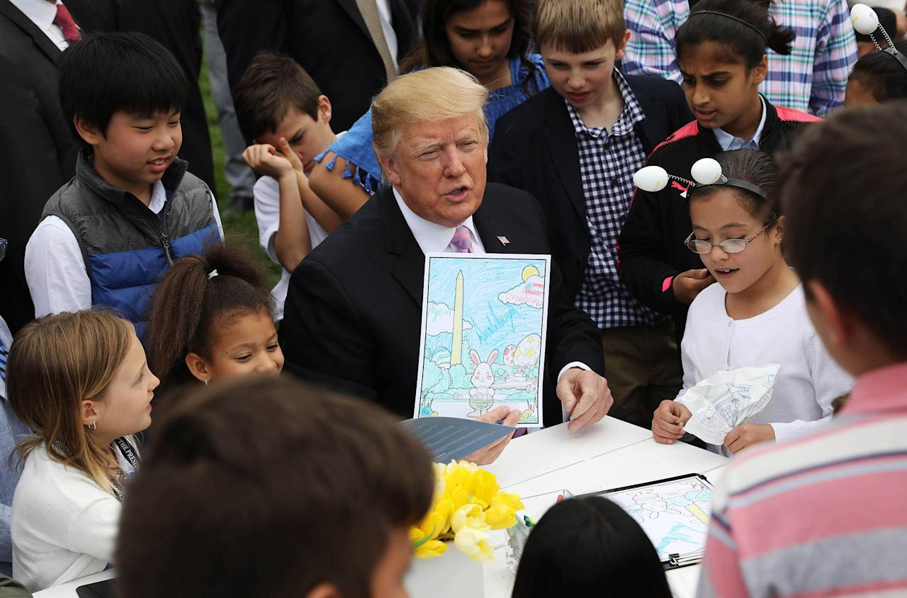 "<p>An assurance the Wall will be built. A diatribe about Robert Mueller and impeachment. Remarks about a terror attack in Sri Lanka. Autographs. Why yes, it's Easter at the White House. During the annual White House Easter Egg Roll-an event that dates back 141 years-Donald Trump, American president, bounced around the lawn talking politics while First Lady Melania Trump played hostess. At one point, as the president colored (and autographed) a picture for U.S. service members, a child sitting next to him allegedly asked about Trump's signature policy, a wall on the southern border. </p><p>Oh, It's happening. It's being built now,"" <a href=""https://www.politico.com/story/2019/04/22/easter-egg-roll-trump-border-wall-1286361"" target=""_blank"">Trump told the kid</a>. ""Here's a young guy who said, 'Keep building that wall.' Can you believe that? He's going to be a conservative someday!""</p><p>Later, he autographed a child's arm. </p><p>Happy Easter. </p><p>Here are 12 photos that show what the Easter Egg Roll is like at the Trump White House. </p>"